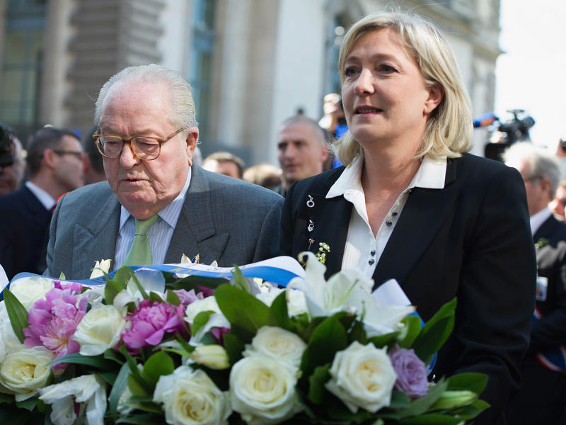 Jean-Marie Le Pen and daughter Marine Le Pen lay down flowers as part of a demonstration in Paris in 2012. Marine Le Pen later expelled her father from the National Front party.