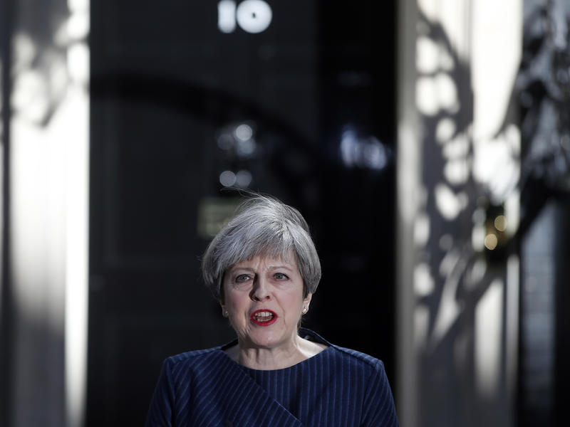 Britain's Prime Minister Theresa May speaks to the media outside her official residence of 10 Downing Street in London on Tuesday. May announced she will seek early election on June 8.