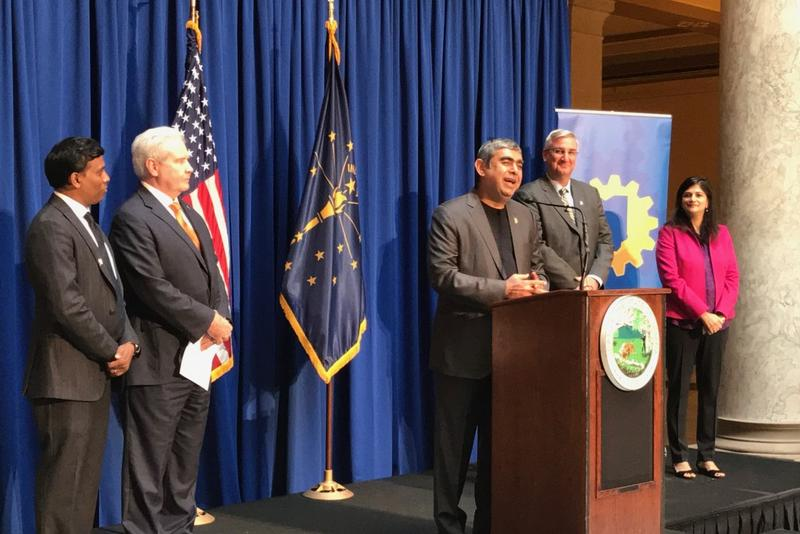 Infosys CEO Vishal Sikka, center, talks about his company's decision to locate in Indiana. He's flanked by state officials and leaders from his company. (Brandon Smith/IPB News)