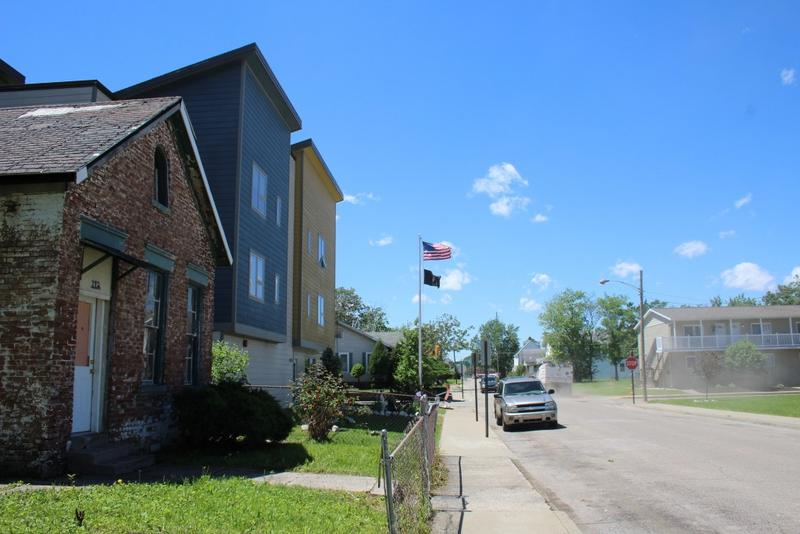 The Jacobsville neighborhood of Evansville is beginning to bounce back from decades of blight and a lengthy lead cleanup process. Here, new veterans' housing mingles with EPA-laid sod and lingering vacant homes. (Annie Ropeik/IPB News)