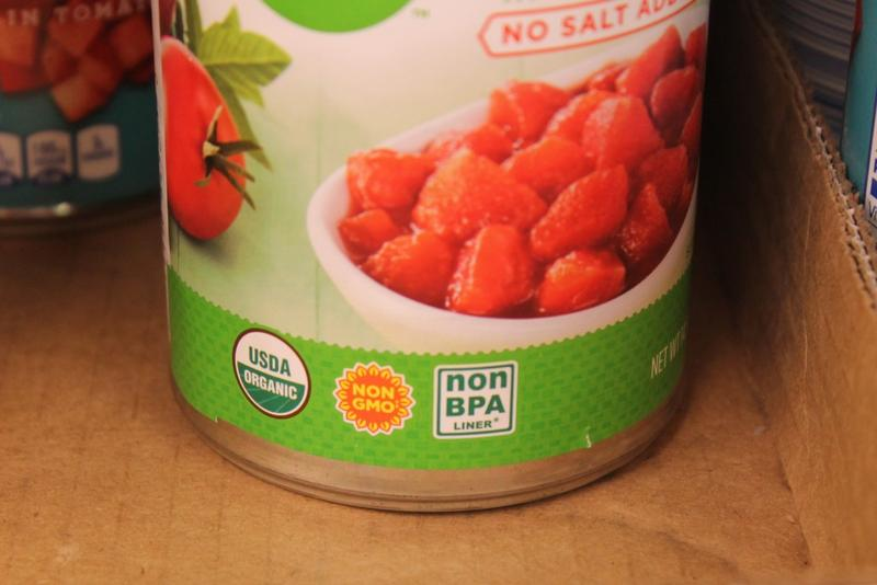 A can of store-brand diced tomatoes includes three different food labels. A new study from Purdue seeks to examine how labels and certification can affect prices and consumer choice. (Lauren Chapman/IPB News)