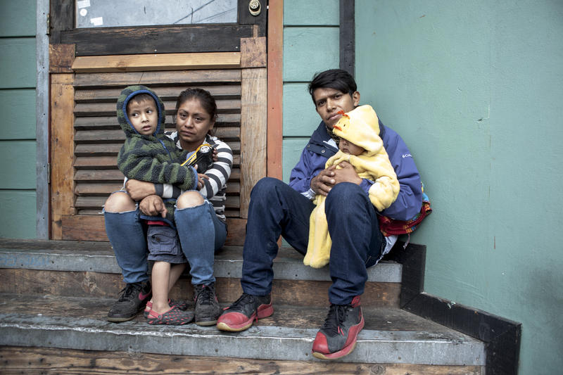 <p>Migrants fleeing violence in El Salvador sit outside the Enclave Caracol space in Tijuana before the Caravan of Refugees approached the US border on Sunday, May 7, 2017.</p>