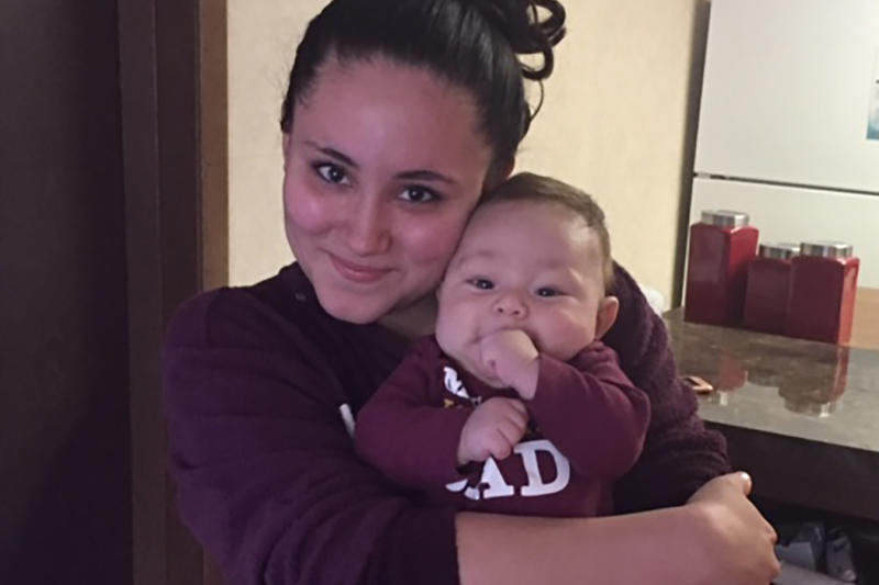 Katherine Peraza poses with her her 3-month-old son. (Jill Sheridan/IPB News)
