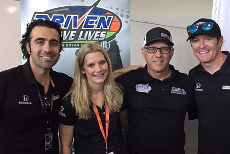 Dario Franchitti, Taylor McLean, Tim Clauson and Scott Dixon at an autograph session for Driven2SaveLives campaign. (Jill Sheridan/IPB News)