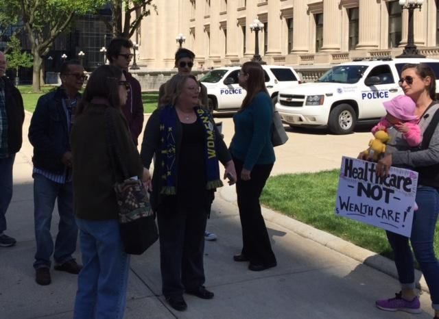 Protesters gather in front of U.S. Sen. Todd Young's offices, calling on him to not support the American Health Care Act. (Jill Sheridan/IPB News)