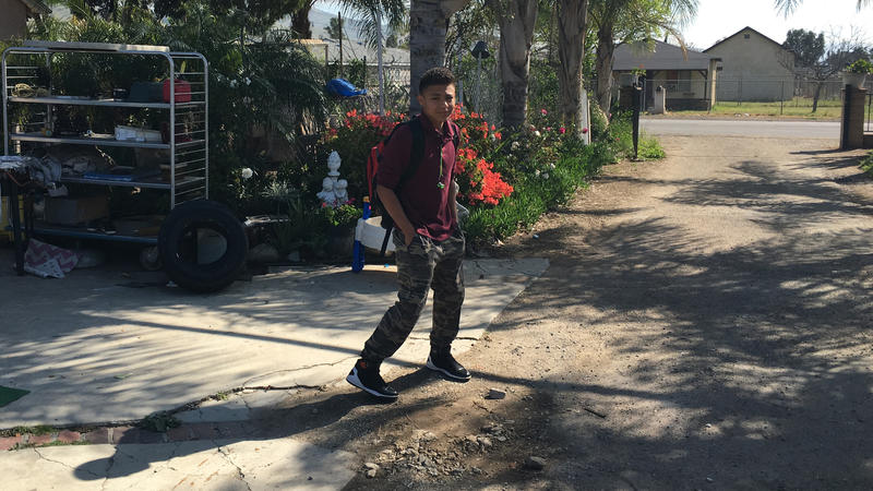 <p>Kevin Alvarez Mejia leaves his house on the way to school in Riverside, California. He fled El Salvador with his sister after being threatened by a gang member.</p>