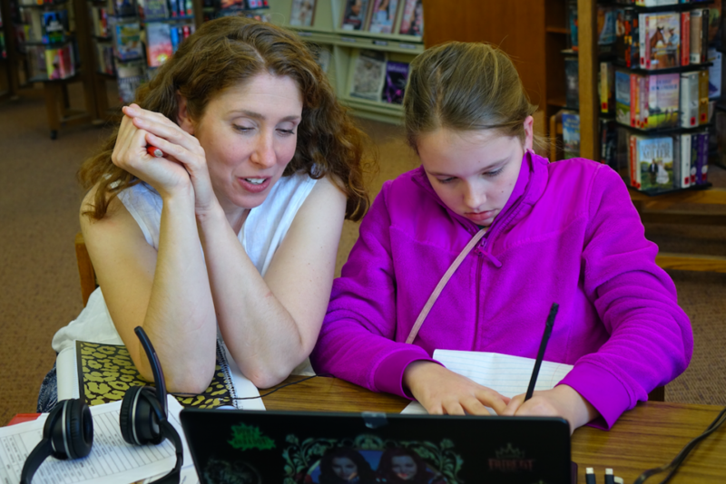 Anna Allman laughs with daughter Piper as they review German language words as part of Piper's Hoosier Virtual Academy foreign language course at the Mooresville Public Library on April 18, 2017. Allman says she'd be devastated if the school was closed be