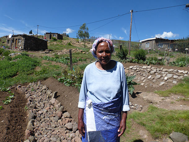 Nasetnaka Ramatse outside her home in Thaba-tseka, Lesotho.