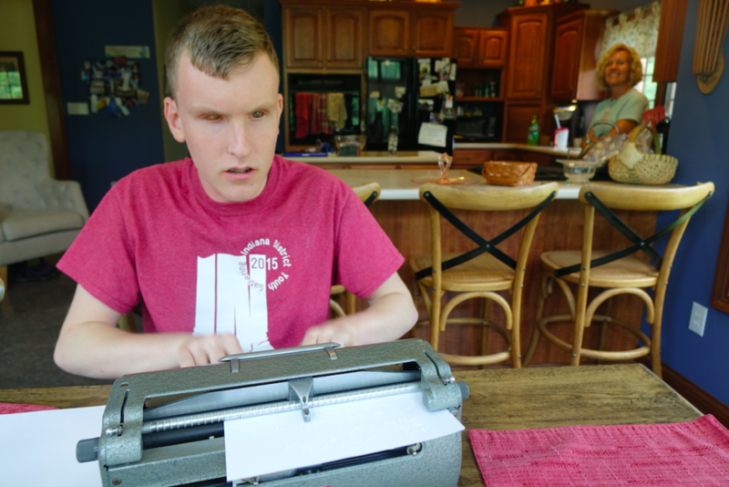 Mitchell Bridwell types on a Perkins Unimanual Brailler in the kitchen of his Pittsboro home as his mother Marta stands in the back, on Wednesday, June 14, 2017. Bridwell, 16, is one of 10 students from the U.S. and Canada to compete in the national Brail