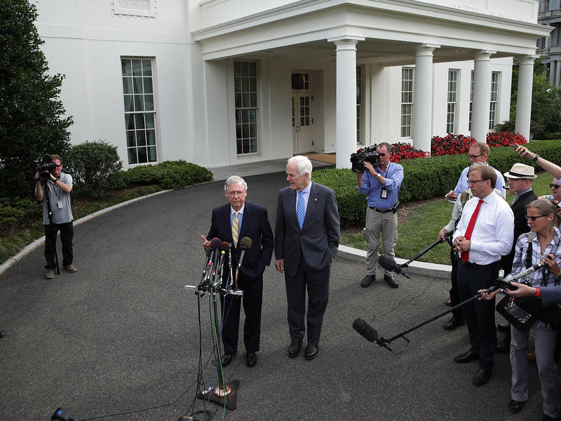 Senate Majority Leader Sen. Mitch McConnell, R-K.Y. (left), and Senate Majority Whip Sen. John Cornyn, R-Texas, speak to members of the media outside the West Wing of the White House on Tuesday in Washington, D.C.