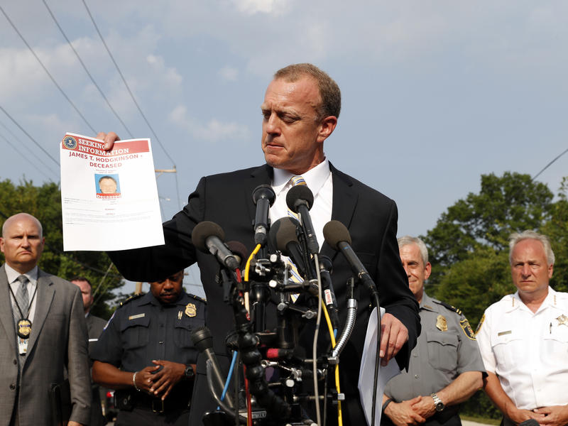 Tim Slater, special agent in charge of the FBI's Washington field office, holds up a flyer looking for information about shooter James T. Hodgkinson at a news conference a week ago in Alexandria, Va.
