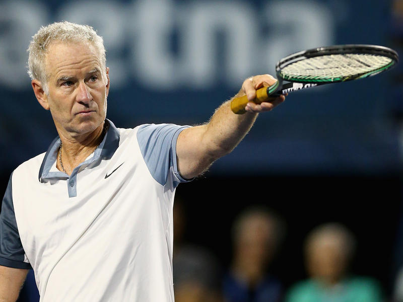 John McEnroe reacts during a Men's Legends match against Jim Courier at the Connecticut Open in August 2015.