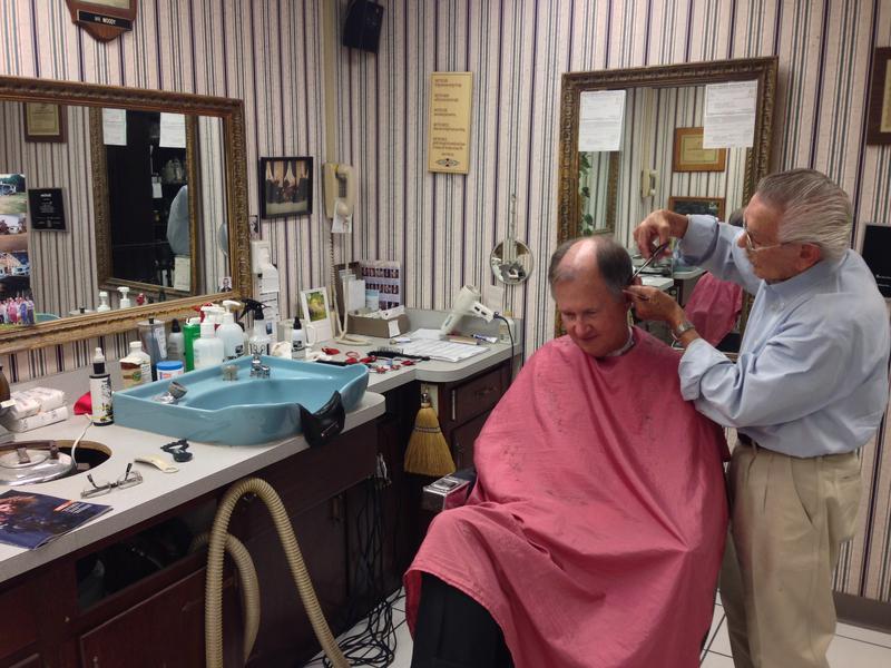 Barber Woody Yaklin and Oklahoma Historical Society Director Bob Blackburn at Mr. Woody's Style Shop.