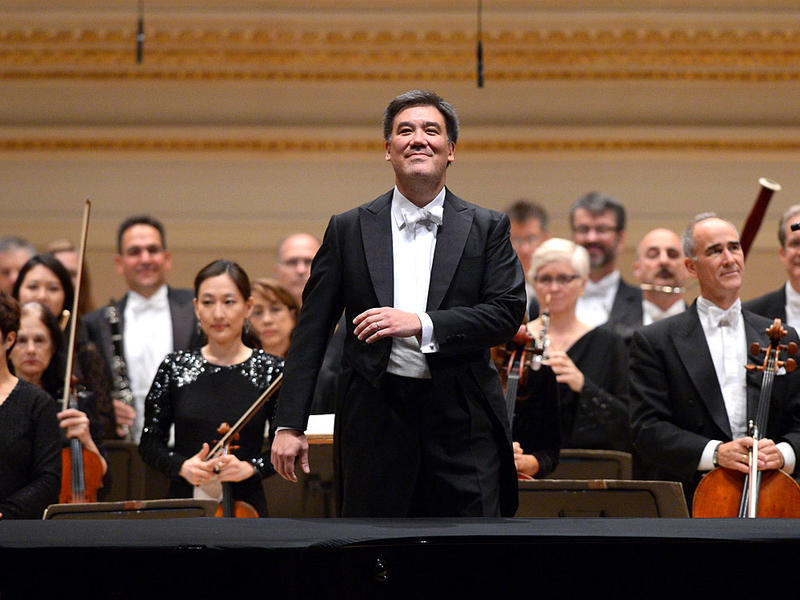 Alan Gilbert (center) with the New York Philharmonic at Carnegie Hall. He has left that orchestra and announced his new position as chief conductor of the NDR Elbphiharmonie, in Hamburg, Germany.