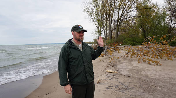 Matt Greene, director of operations at Presque Isle State Park, said government funds help fight beach erosion that uproots trees.
