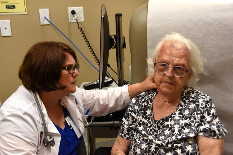 Jennifer Carnahan, MD of the Regenstrief Institute and Indiana University Center for Aging Research and Indiana University School of Medicine examines an Eskenazi Health patient. (Photo courtesy of Eskenazi)