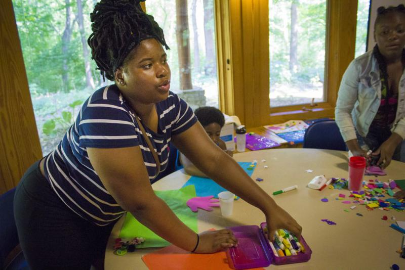 Camper Chandra works on an art project that depicts a chapter of her life. (Peter Balonon-Rosen/Indiana Public Broadcasting)