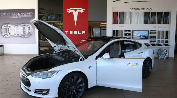 A Tesla Model S car is displayed at a Tesla showroom on November 5, 2013 in Palo Alto, California.