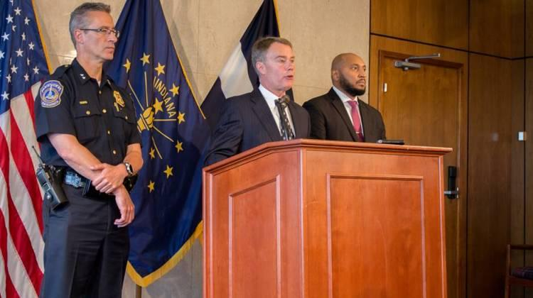 Indianapolis Mayor Joe Hogsett (center), announces reforms for IMPD with Chief Bryan Roach (left) and Deputy Mayor of Neighborhood Engagement David Hampton (right).