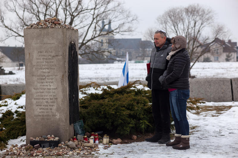 <p>Higay and Adi from Israel, in front of the monument dedicated to the Jews murdered by the local population in 1941. The monument was erected in 2001. In the background stands the St. Jacob Church. </p>