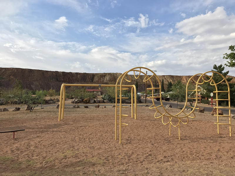 A mountain of mine tailings frame a Bisbee park — a legacy of the copper mines that once fueled the local economy.