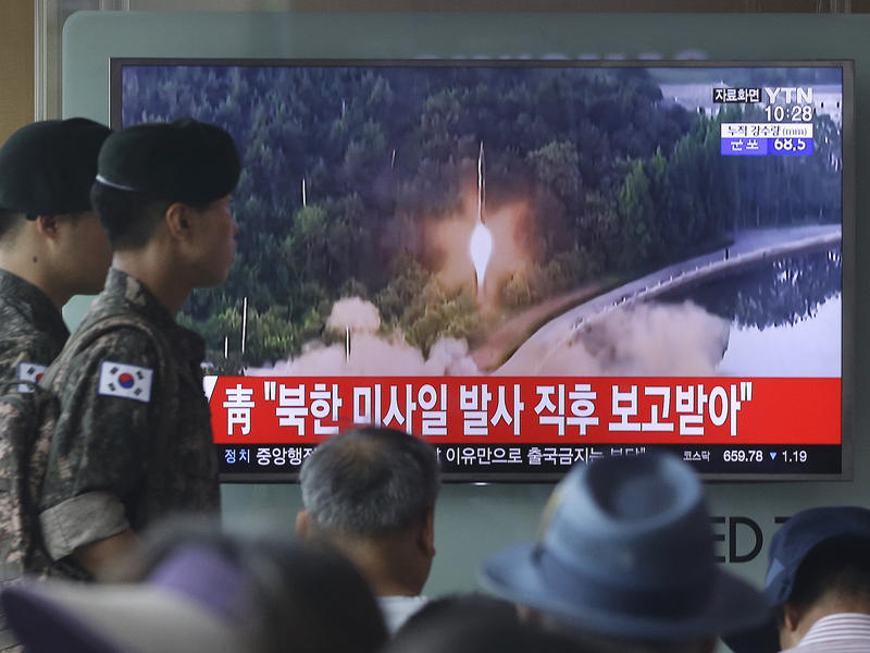South Korean soldiers in Seoul walk by a TV news program showing a file image of a missile being test-launched. North Korea on Tuesday test- launched another ballistic missile in the direction of Japan, U.S. and South Korean officials said.