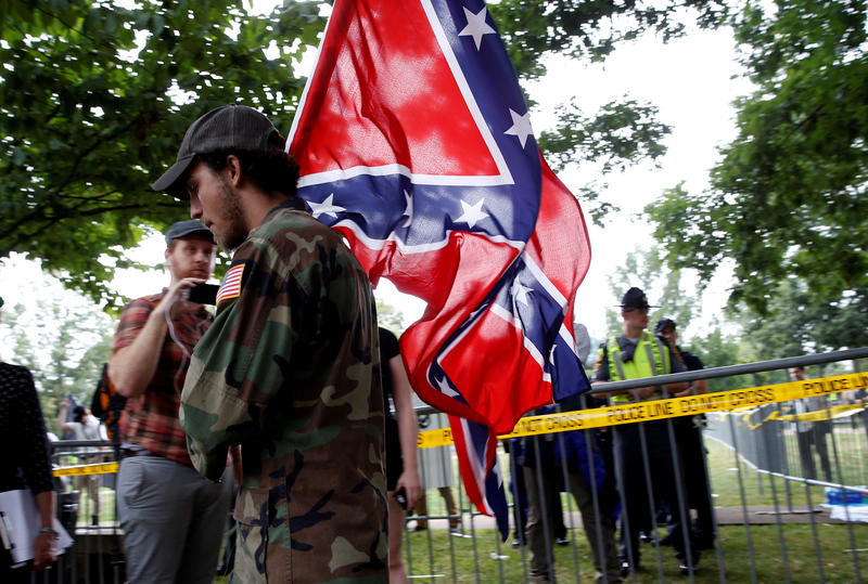 <p>A white nationalist carries the Confederate flag as he arrives for a rally in Charlottesville, Virginia, US, August 12, 2017.</p>