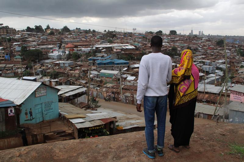 Ben and Salma are studying journalism at the Nairobi community news hub, Habari Kibra. They are looking out over their home, Kibera, one of the largest slums in the world.