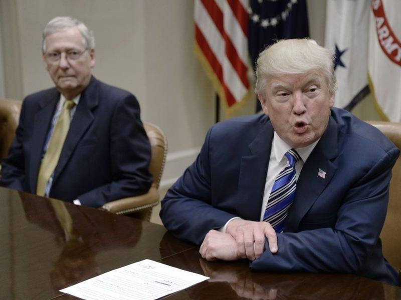 President Trump speaks as Senate Majority Leader Mitch McConnell, R-Ky., looks on during a meeting with House and Senate leadership at the White House back in June.