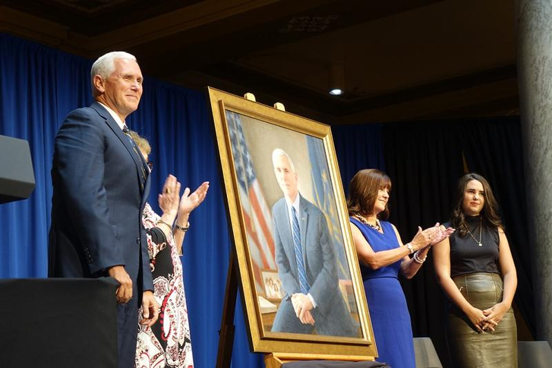 Vice President Mike Pence, his mother, wife Karen, and youngest daughter unveil his gubernatorial portrait. (Lauren Chapman/IPB News)