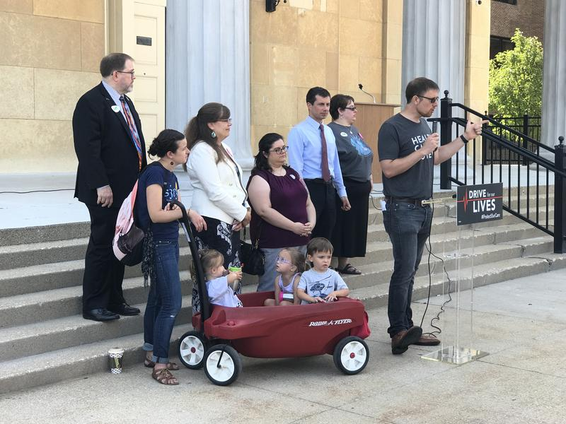Ben Wikler, with the organization MoveOn, talks to a crowd at the Old Court House in South Bend. Mayor Pete Buttigieg and community health care advocates shared stories about the impact of the Affordable Care Act.