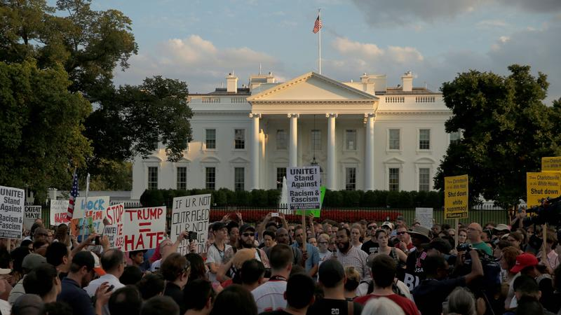 <p>People gather for a vigil in response to the death of a counterdemonstrator at the Unite the Rightrally in Charlottesville,outside the White House, on Aug.13, 2017.</p>