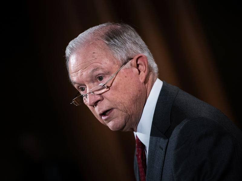 "Attorney General Jeff Sessions speaks at the Department of Justice on Aug. 4. The Justice Department is being sued by multiple cities, including now Los Angeles, over its stance on ""sanctuary cities."""