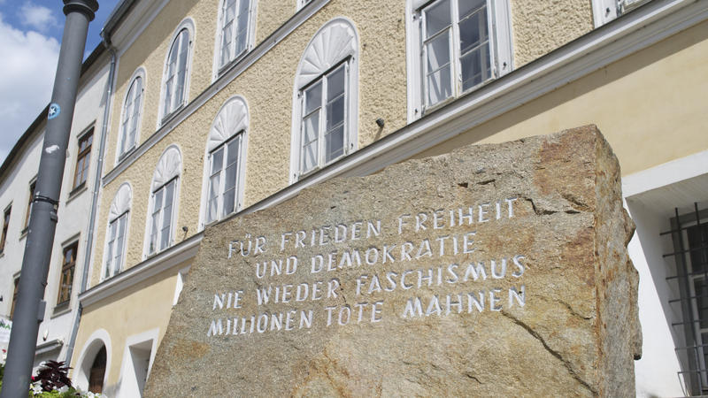 "<p>Outside the house in Austria where Adolf Hitler was born there's a block of stone from the Mauthausen concentration camp. It reads ""for peace freedom and democracy, never again fascism, remember the millions of dead.""</p>"