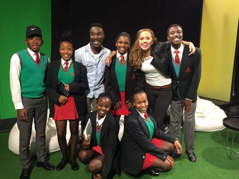 <p>MTV Host Tinashe Venge, center, and Across Women's Lives reporter Jasmine Garsd, second from right, stand with South African students after a live discussion about HIV/AIDS in their country.</p>