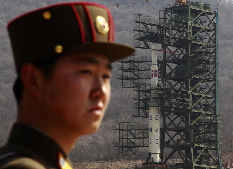 <p>A soldier stands guard in front of the Unha-3 rocket sitting on a launch pad at the West Sea Satellite Launch Site in Pyongyang. </p>