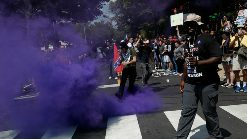 <p>A smoke bomb is thrown at a group of counter-protesters during a clash against members of white nationalist protesters in Charlottesville, Virginia, U.S., August 12, 2017. </p>
