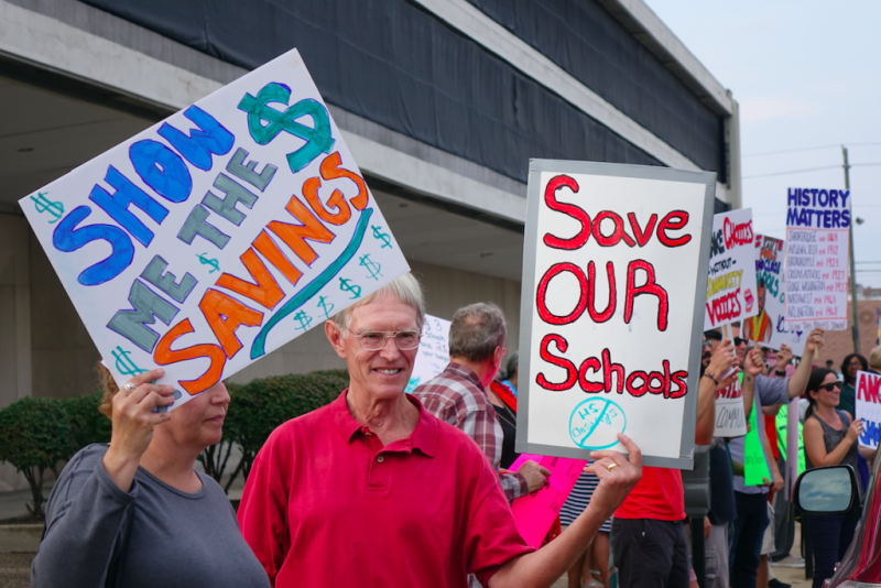 Protestors against the Indianapolis Public Schools administration's proposal to close multiple high schools rally outside the John Morton Finney Center before the final school board vote on Monday, Sept. 18, 2017. (Eric Weddle/WFYI News)