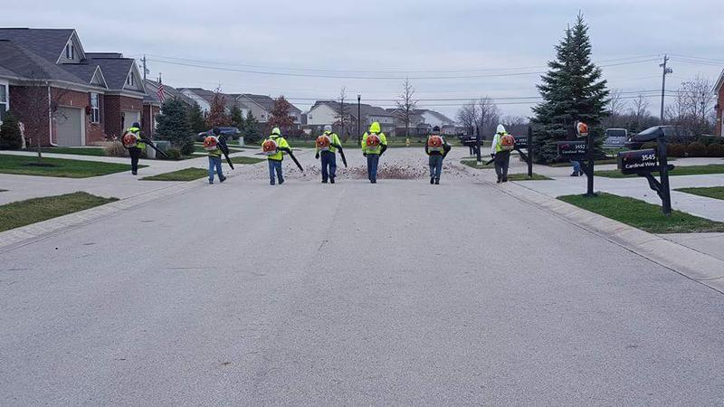 Indianapolis-area companies like Ski Landscaping, whose workers are seen on the job here, make up the bulk of Indiana's relatively small number of H-2B visa users. (Courtesy Ski Landscaping)