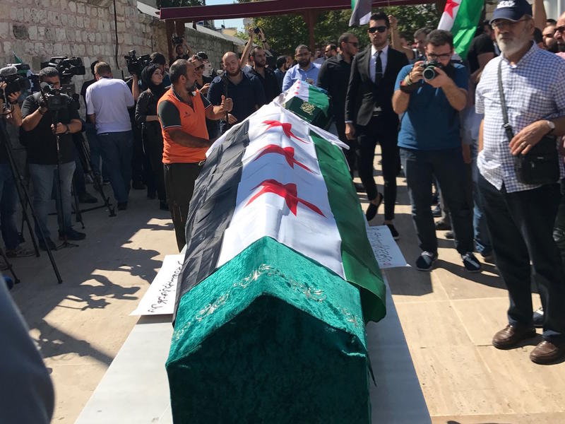The caskets of slain mother and daughter Orouba and Halla Barakat are prepared for the funeral in Istanbul.