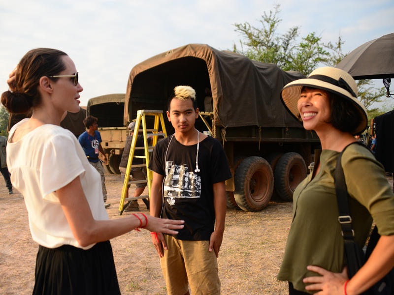 Jolie (left) and Ung (right) worked together to film First They Killed My Father in Cambodia. (Also pictured: Jolie's son, Maddox Jolie-Pitt, center.)