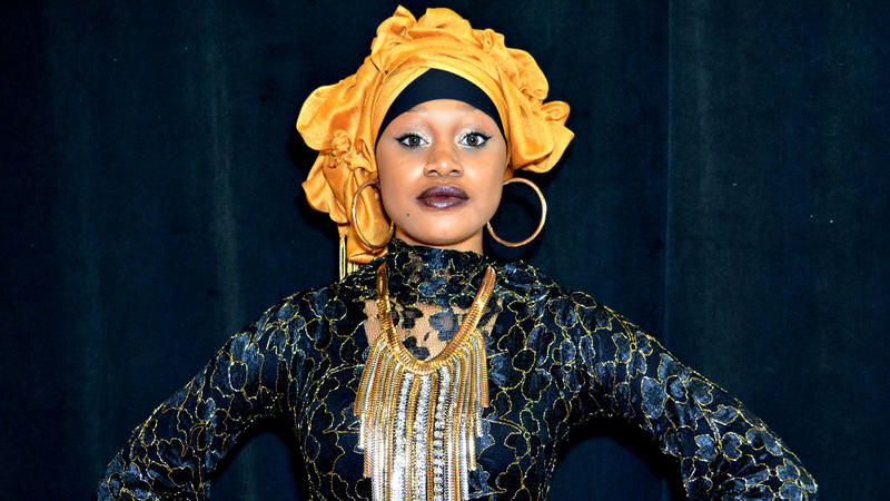 <p>A model wearing a gold headwrap poses at a past Beautifully Wrapped Headwrap Expo. During the event, fashion shows take place every hour and features different looks from designers.</p>