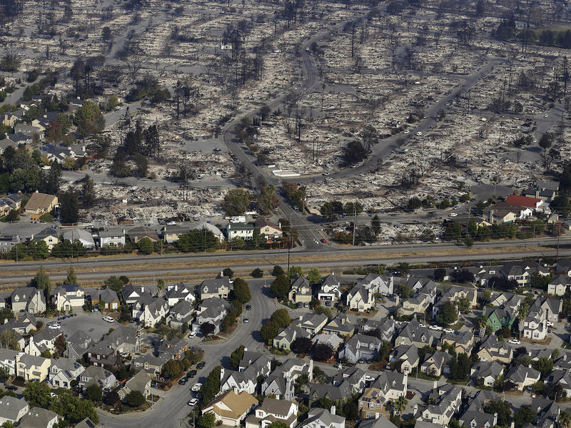 Homes destroyed from fires are seen from an aerial view in Santa Rosa. Gov. Jerry Brown has declared a state of emergency for Napa, Sonoma and Yuba counties.