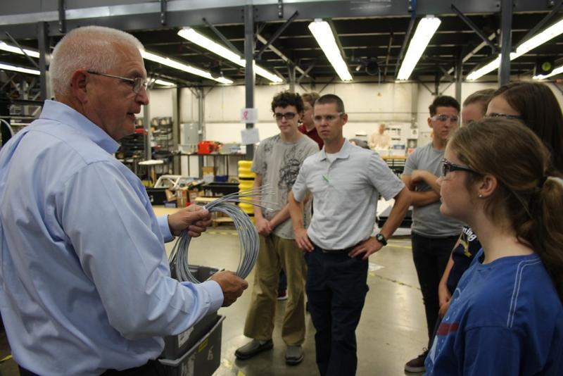 Students from Carroll Junior-Senior High School get a tour of Kirby Risk in Lafayette. Their industrial technology teacher is Tyler Sausaman, center. (Annie Ropeik/IPB News)
