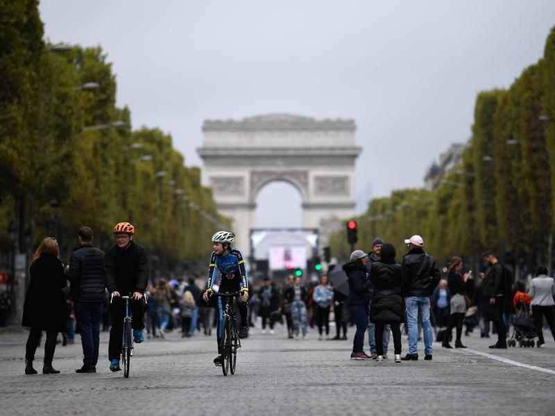 Mayor Anne Hidalgo has called for an end to gas-powered vehicles in Paris by 2030, in favor of biking, transit, and electric cars. Here, cyclists and pedestrians on the Champs- Élysées during the city's