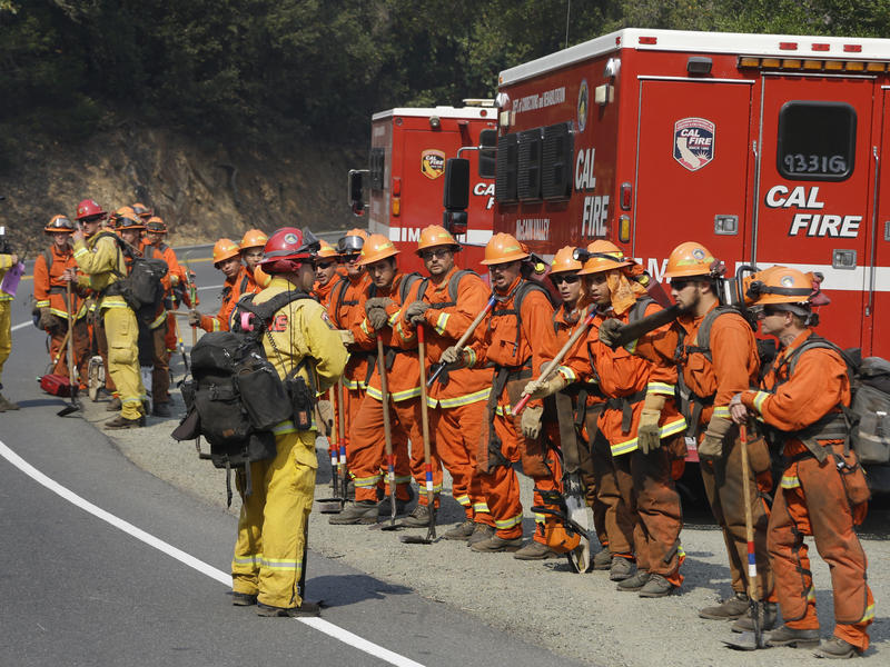 Prisoners from the McCain inmate crew from San Diego prepare to clear brush from a road on Wednesday in Calistoga.