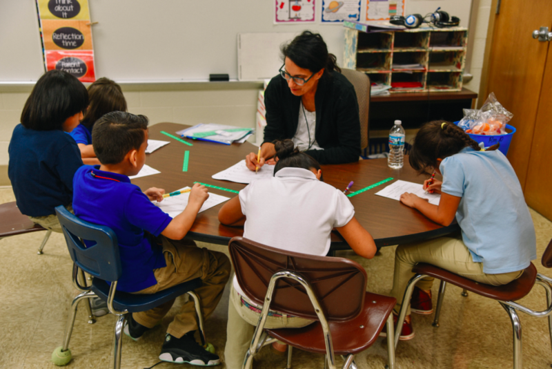 A teacher and students work at Indianapolis Public Schools' Meredith Nicholson School 96. (Credit: IPS)