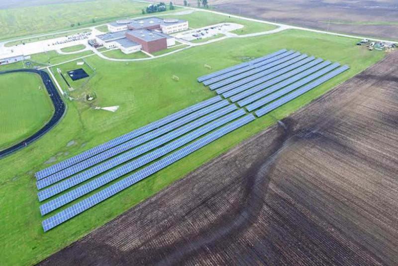 Solar panels at Lowel Middle School abutting a corn field (photo courtesy of Tri-Creek School Corp.)