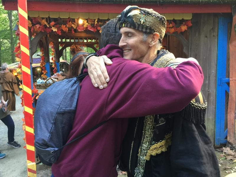 Johnny Fox hugs a fan at the Maryland Renaissance Festival. This fall, Fox has made a triumphant comeback even as he battles with health issues.