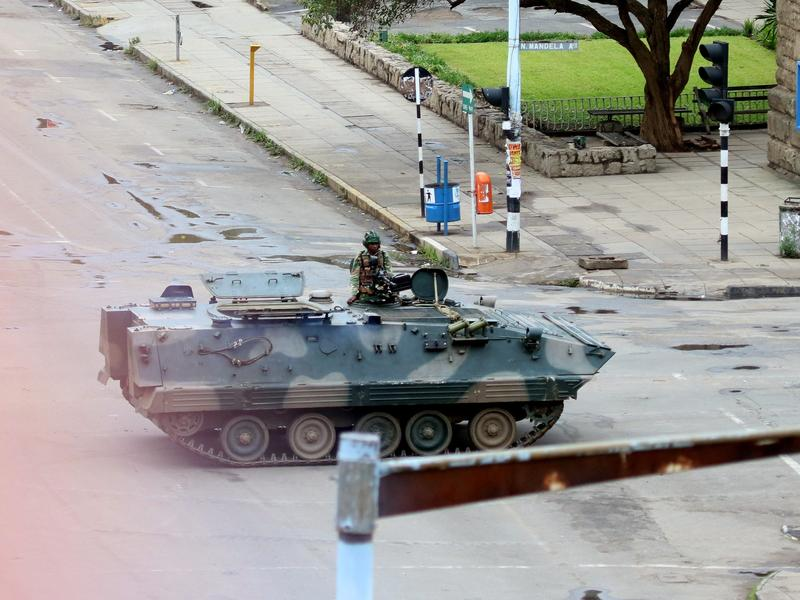 An armored personnel carrier seals off a main road to the presidential office in Harare, Zimbabwe on Wednesday.